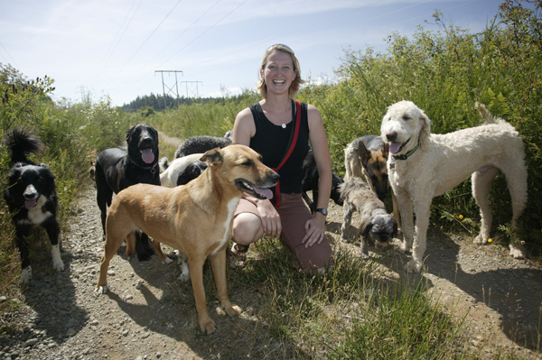 "Megan Hird with her charges, including her ""number one"" dog, Kayla (front left)."
