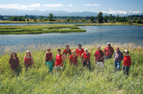 Members of Project Watershed—wearing red in support of the heart of the watershed—help spread the word at the Courtenay River Estuary.  Pictured are Barbara Price, Suzanne Murray,Gayle Ord, Steph Nathan, Don Castleden, Ruby Berry, Tom Dishlevoy, Ronna-Rae Leonard, Ron Wall, Jack Minard, Dave Lacelle, Krista Kaptein.