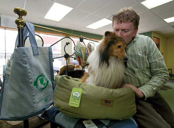 """The Wags Bagz project provides multiple benefits for everyone,"" says Bill Weston, at Wagz with his dog Fergus and some of the products created by the Beaufort Association with the donated denim."