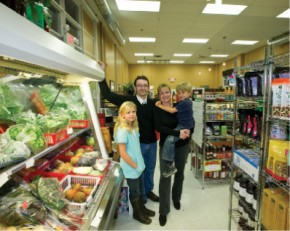 """""""Our mandate is it has to taste good, it has to support the economy, and it has to help the producers make a living,"""" says Angeline Street, with husband James and their kids inside Brambles Market in Downtown Courtenay."""
