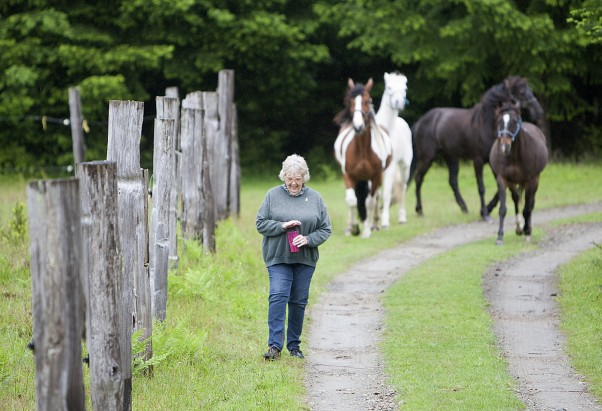 """There's another dimension you get into when you're with horses,"" says Martha Crawford Cantarini, now living on Denman Island. ""There's a bond.""  Photo by Boomer Jerritt."