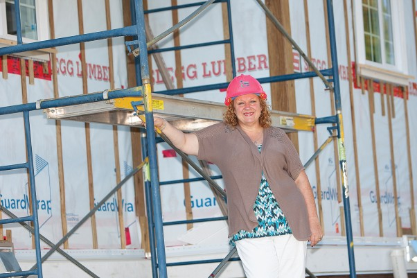 """Though Habitat is made up of many workers, the volunteers are the real heroes of our organization,"" says Deb Roth at the build site.  Photo by Boomer Jerritt"