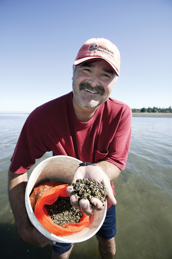 Richard Hardy shows off some clam seeds in Comox Bay. The pristine waters surrounding the Comox Valley produce more than 50 per cent of all of BC`s seafood. This location, and the vibrant aquaculture industry here, are the perfect combination for bringing visitors and industry together, to educate and taste the very best the ocean has to offer. Photo by Boomer Jerritt