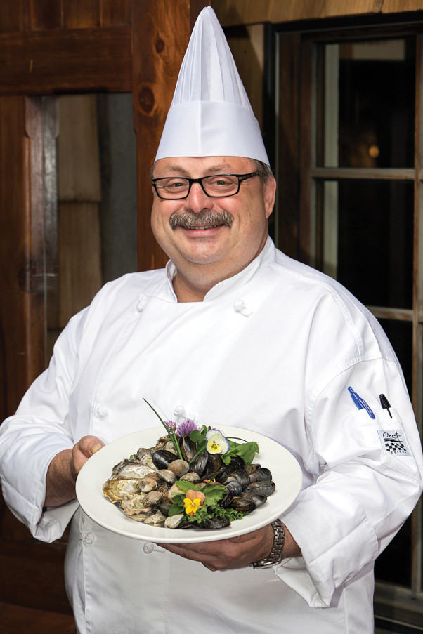 Chef Ronald St. Pierre of Locals Restaurant is proud that his extensive use of locally grown and harvested seafood has helped his establishment earn a Level III distinction in the Leaders in Environmental Food Service certification program. Locals is the only restaurant in BC to achieve this high level of excellence, which identifies it as one of Canada's 'greenest' restaurants. Photo by Boomer Jerritt