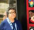 Dr. Evelyn Voyageur-Savoie, Elder in Residence at North Island College, wrote a book to tell the story of the button blanket project.  Photo by Boomer Jerritt