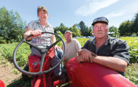 """""""The reward is simple—it's the lifestyle,"""" says Bob Sieffert, right, with wife Charlene and partner Chris Edwards at Sieffert's, which has been his family's farm since 1959. """"There's plenty of variety in my day and I'm outdoors. And it's satisfying to produce food. We're doing something that makes people happy."""" Photo by Boomer Jerritt"""